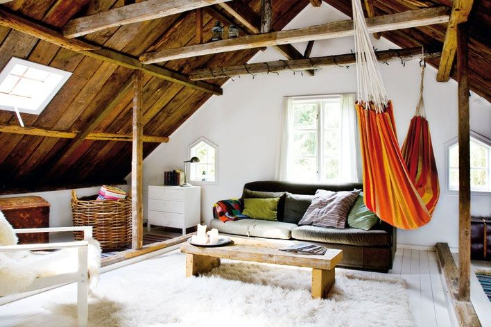 Bright red and orange hammock in a spacious attic