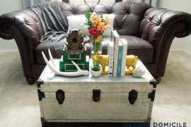 Bright silver metal trunk with lots of accessories  16 Old Trunks Turned Coffee Tables That Bring Extra Storage and Character Bright silver metal trunk with lots of accessories 270x180