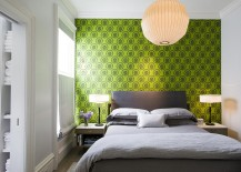 Bright wallpaper from Cole & Sons coupled with hints of gray in the bedroom