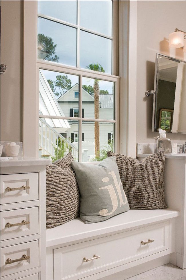Built-in bathroom window seat with storage