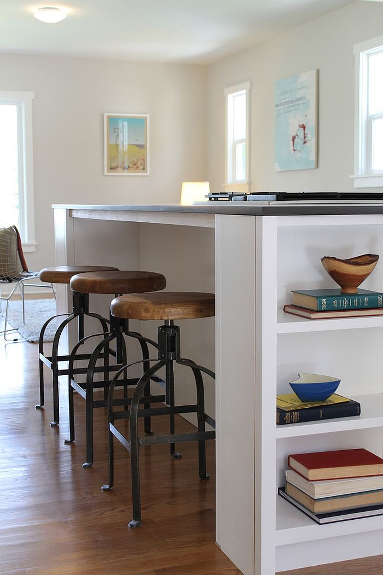 Built-in shelving for cookbooks complete the contemporary kitchen island [Design: Madison Modern Home]