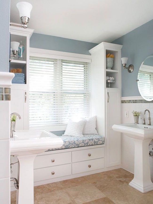 Built-in window seat in large bathroom