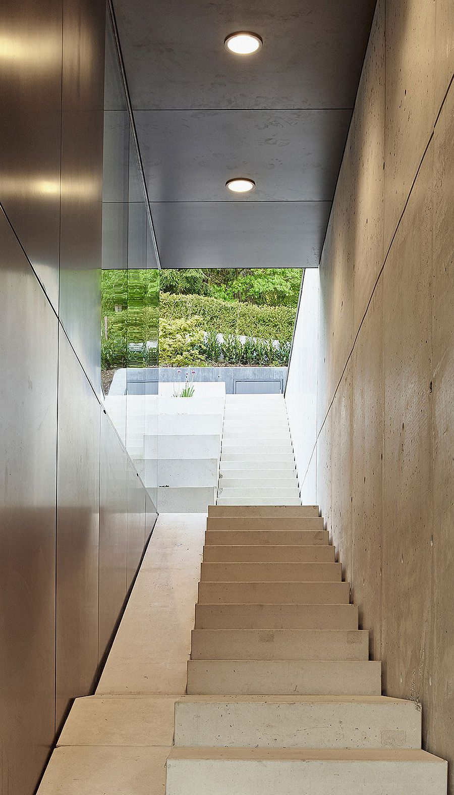 Central staircase the connects the various levels of the house with outdoors