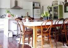 Charming eclectic eat-in kitchen with vintage cabinet in green in the corner [Photography - Kate Hansen]