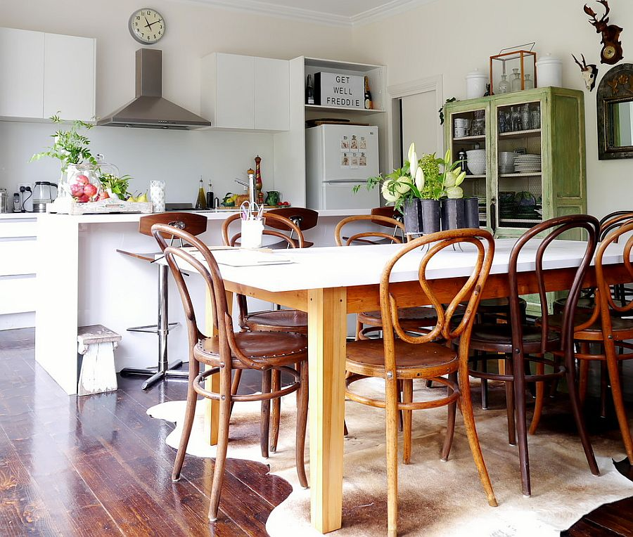 Charming eclectic eat-in kitchen with vintage cabinet in green in the corner [Photography – Kate Hansen]