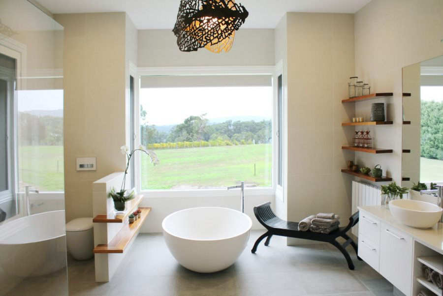 Charming rustic-modern bathroom with a round tub
