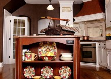Cherry wood kitchen island with delightful kitchenware on display
