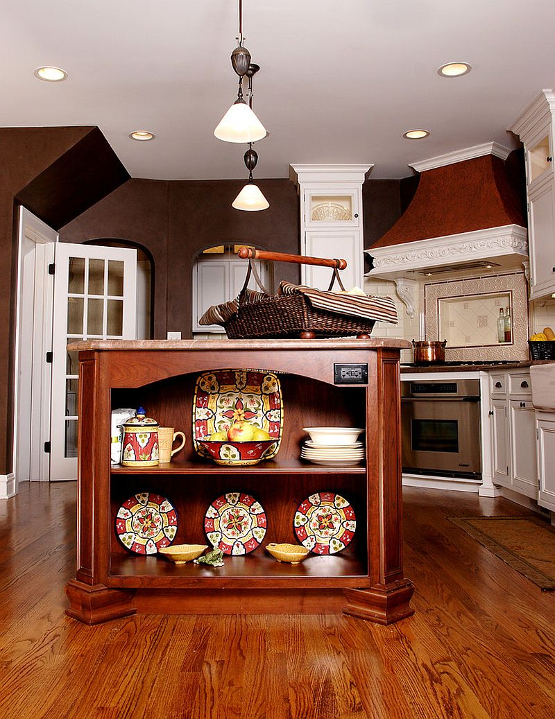 Cherry wood kitchen island with delightful kitchenware on display [Design: Normandy Remodeling]