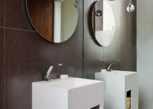 Circular mirrors and stunning pendant lights inside contemporary bathroom in gray