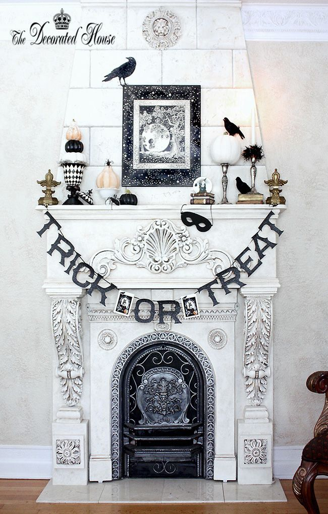Classy Halloween decor that doesn't cover up this fireplace's beautiful details