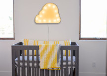 Cloud-shaped marquee sign hung above crib