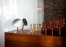 Collection of brown bottles on a floating console