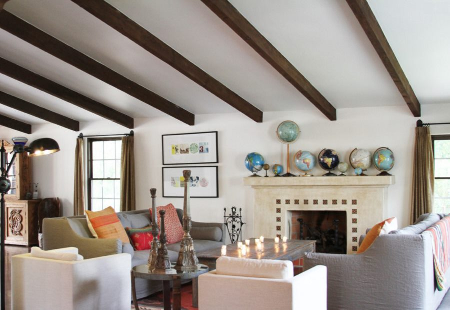 Collection of globes on a fireplace mantel