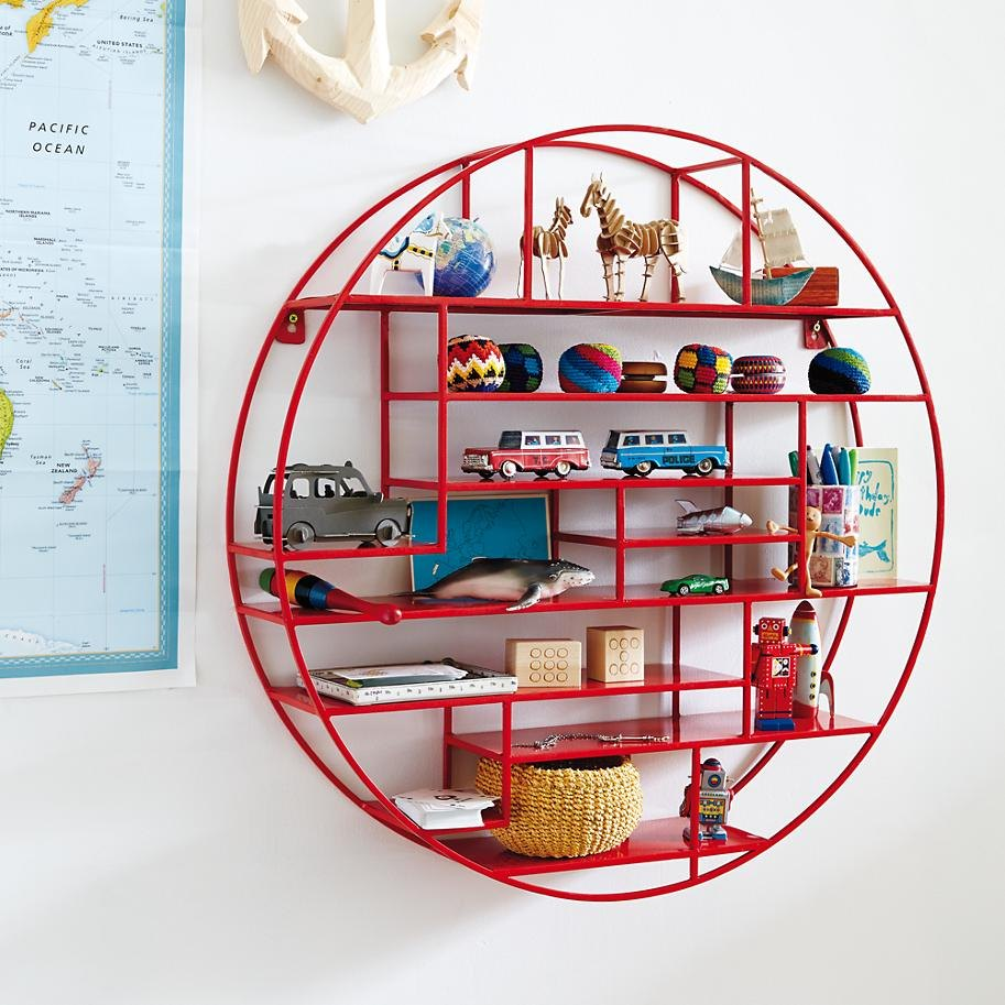 Collection of toys on a round red shelf