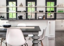 Collections of glass and dinnerware on open kitchen shelving