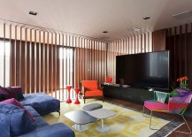 Colorful TV room in Brazilian home is part of a larger living space