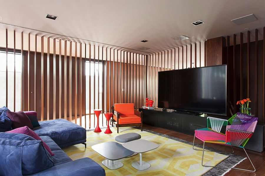 Colorful TV room in Brazilian home is part of a larger living space [Design: Suite Arquitetos]