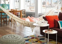 Colorful and bright apartment with a hammock in the living room 217x155 18 Indoor Hammocks to Take a Relaxing Snooze In Any Time