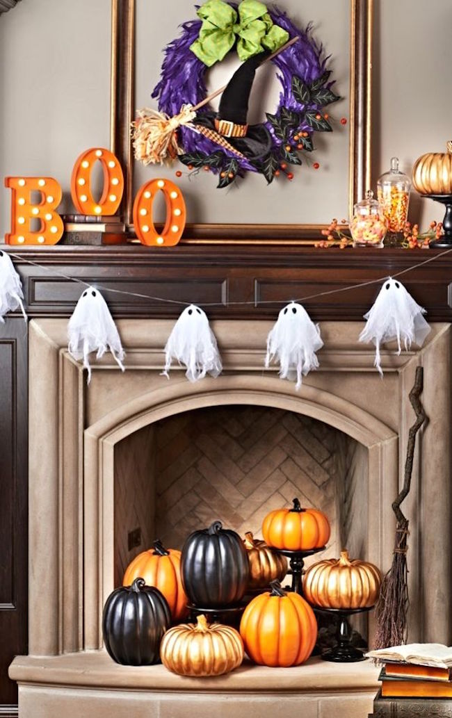 Colorful fireplace with bright orange and black pumpkins