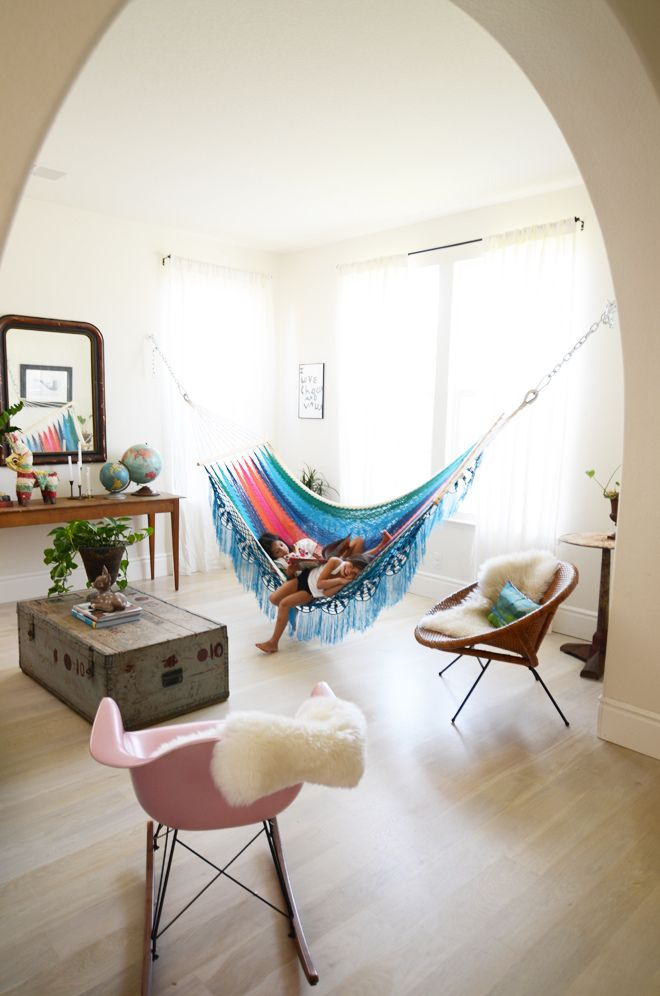 Colorful hammock added to a room in place of a couch