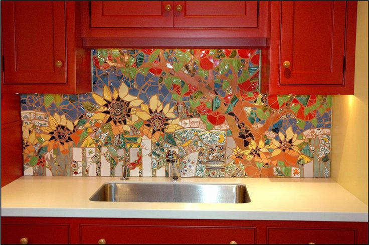 Colorful mosaic backsplash featuring flowers