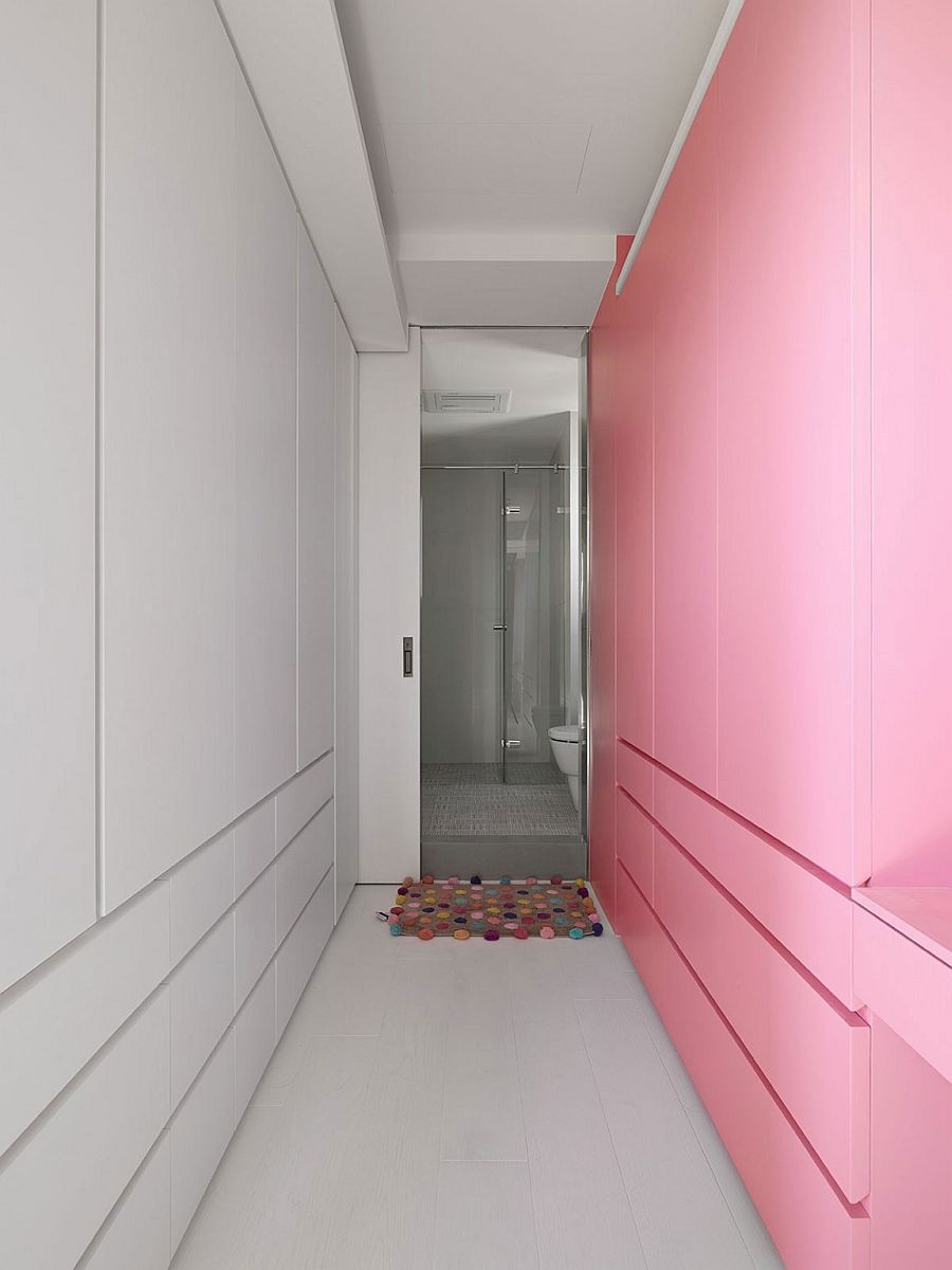 Colorful pink wall brings playfulness to the contemporary home