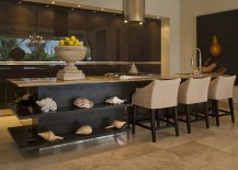 Conch-shells-and-corals-create-a-lovely-display-for-the-tropical-kitchen-217x155