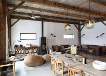 Concrete slab with radiant heating system makes up the floor of the rustic living room