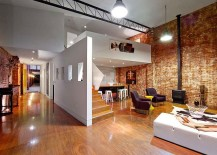 Contemporary additions to the warehouse home give it a more modern twist 217x155 Beautiful Brick Walls: Warehouse Conversion in Fitzroy Conceals Twin Delights