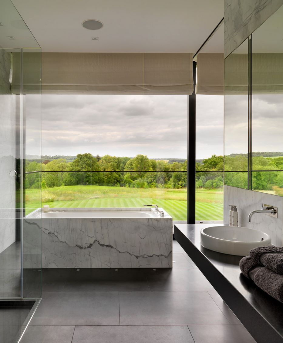 Contemporary bathroom with a lush green view