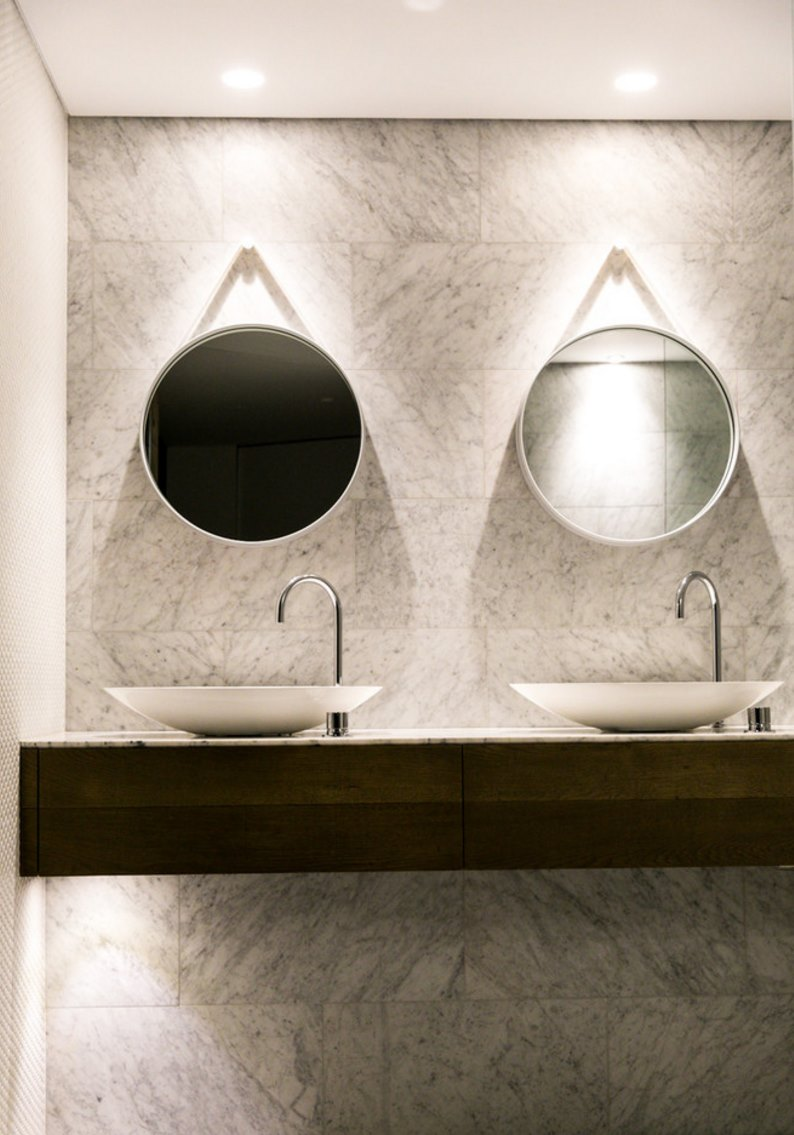 highend bathroom accessories with modern style - view in gallery contemporary bathroom with a pair of round mirrors