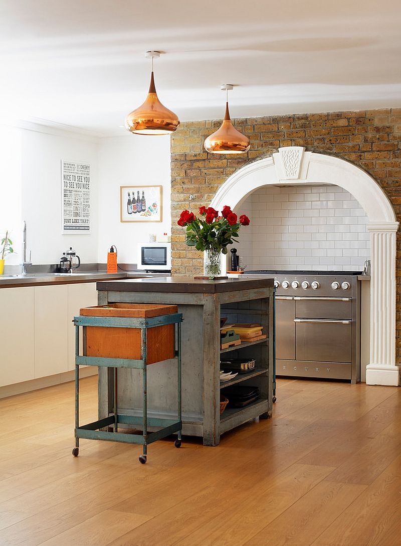Copper pendants and central island steal the show in this kitchen [Design: Redesign London Limited]