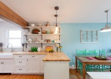 Cozy-eclectic-space-with-vintage-style-socket-lights-and-warm-wooden-surfaces-217x155