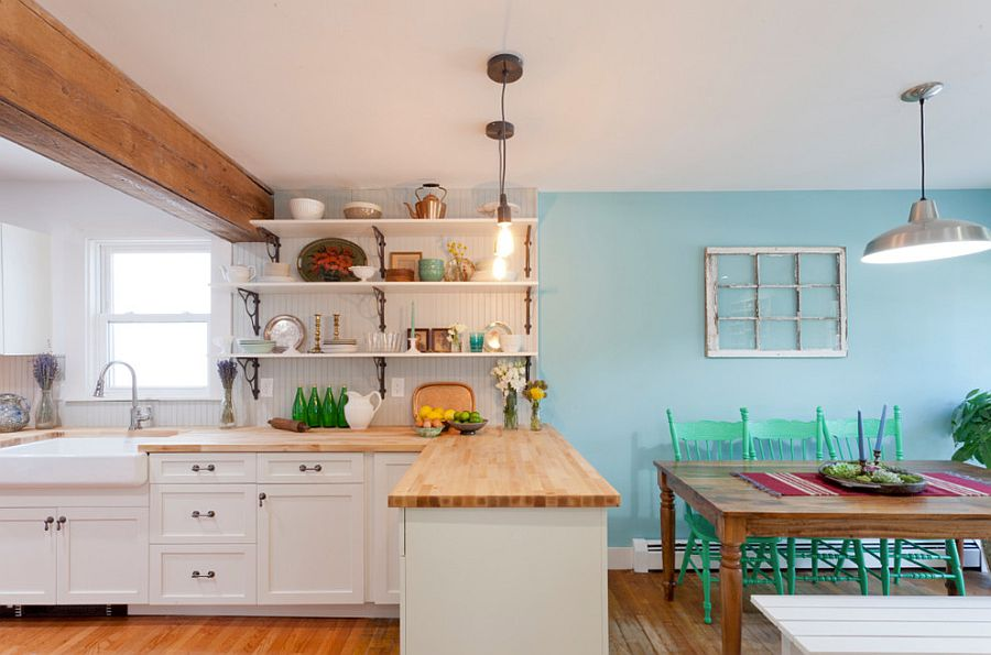 Cozy eclectic space with vintage style socket lights and warm wooden surfaces [Design: The Cousins]