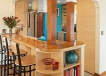 Craftsman-style-kitchen-island-with-breakfast-bar-and-open-shelving-at-the-end-217x155