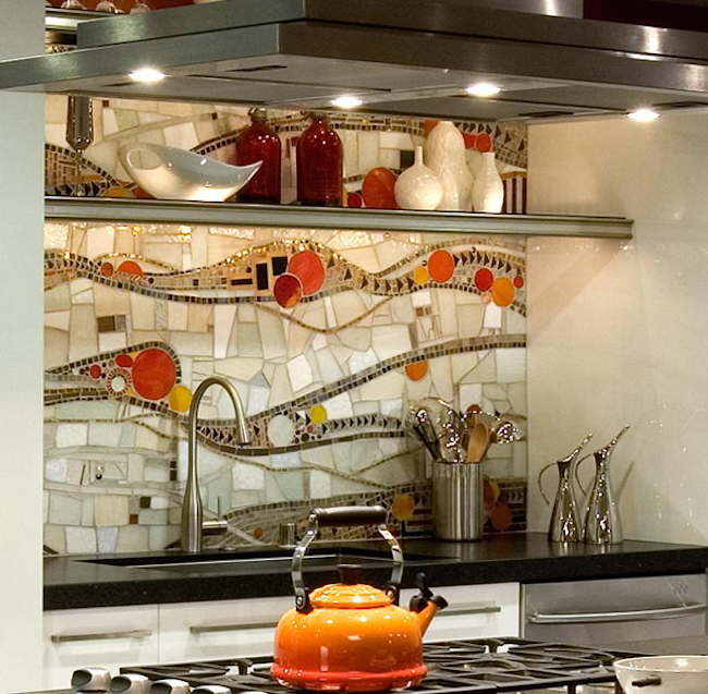 Creative backsplash design with sublte pops of orange and red