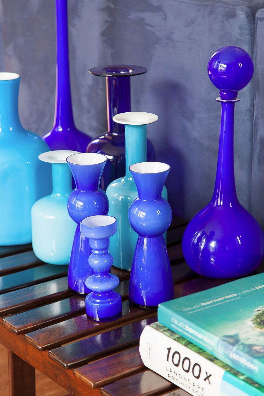 Curated collection of glossy vases in various shades of blue