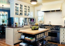 Custom-built-kitchen-island-in-cherry-wood-stained-with-open-shelves-217x155