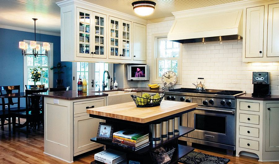 Custom built kitchen island in cherry wood stained with open shelves [Design: Anna Berglin Design]