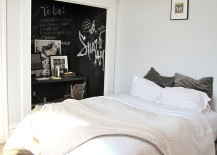 Dark chalkboard paint creates lovely visual contrast and a focal point in the bedroom
