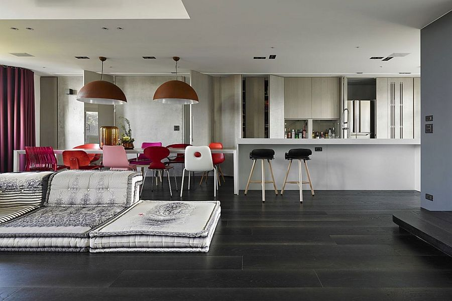 Dark floors create a visual contrast in the lliving area
