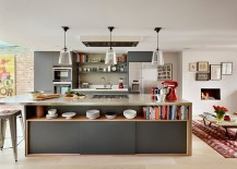 Dashing kitchen island in gray with open shelving and sleek stainless steel countertop