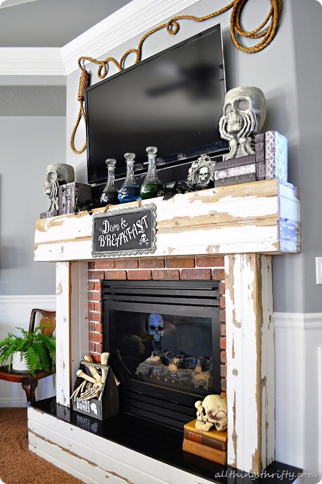 'Dead & Breakfast' Halloween decor for a fireplace with room for a TV