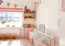 Decor and accessories bring color into this Scandinavian nursery