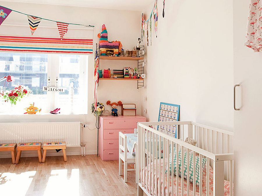 Decor and accessories bring color into this Scandinavian nursery [Photographer: Lisbet Spörndly]