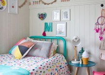 Decor and bedding bring the color into this eclectic bedroom