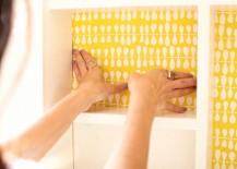 Decorative paper lines a medicine cabinet
