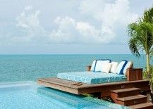 Dream-deck-next-to-the-pool-and-ocean-blends-tropical-flavor-with-beach-style-217x155