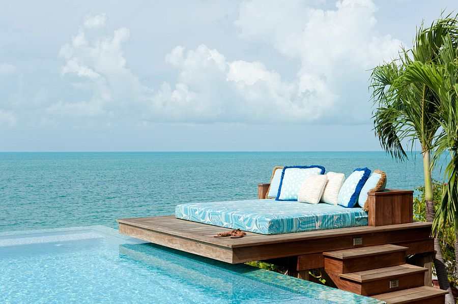 Dream deck next to the pool and ocean blends tropical flavor with beach style [Design: LKID / Steve Passmore Photography]