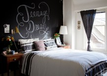 Eclectic bedroom with a chalkboard paint wall behind the headboard